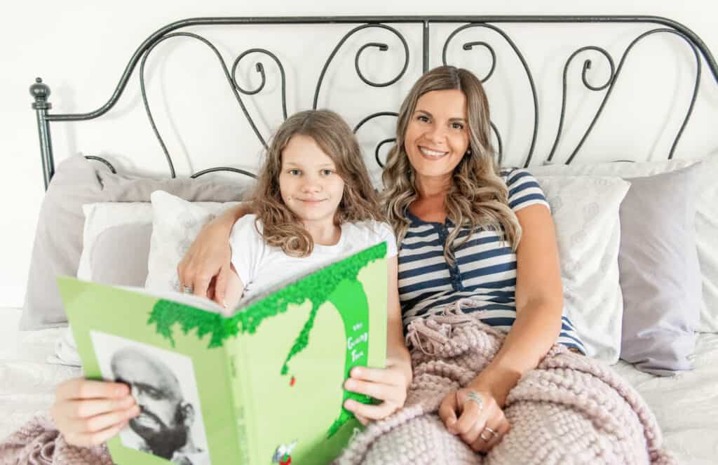 Lorraine Driscoll reading with her daughter